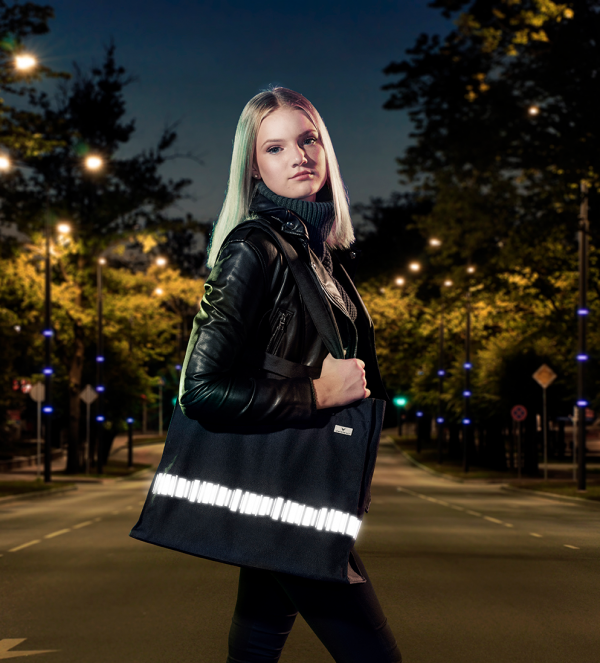 Spacious bag with reflectors and double handles